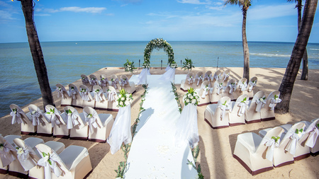 Wedding setting,beach wedding,wedding chairs Editorial