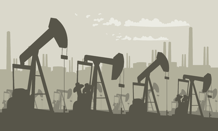 Oil pumps on field with refinery silhouette.