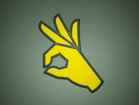 O.K. hand on yellow color photo