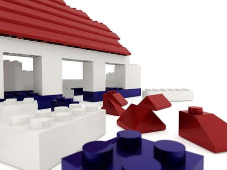 Destroyed toy house on white background photo