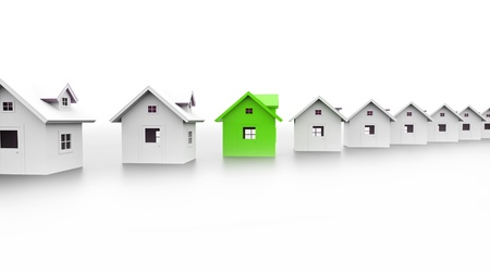 Houses concept one is green on white background Stock Photo