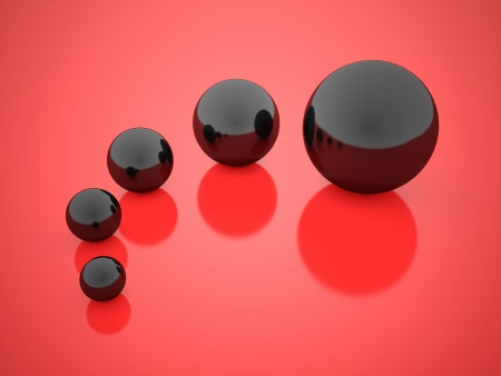 Black concept spheres with reflection on red background