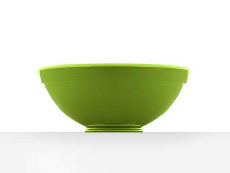 Green bowl isolated on white background photo