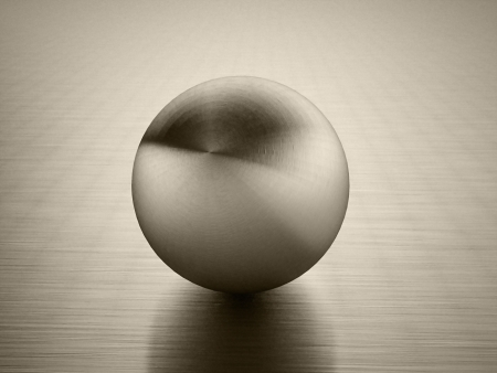 Abstract metal sphere with reflection on dark background photo