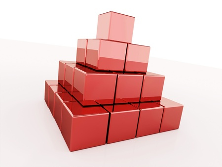 Red pyramid of cubes on white photo