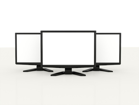 Three LCD monitors with white screen on white background photo