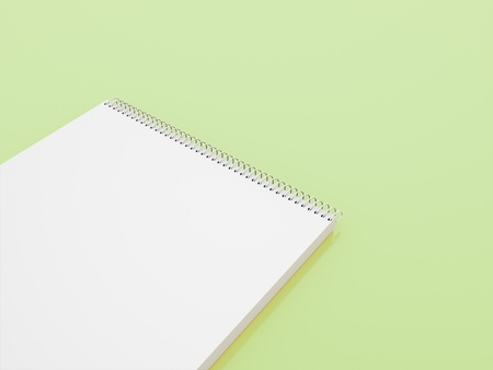 Sketch book on green background photo