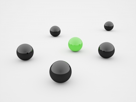Black spheres one green isolated on white background photo