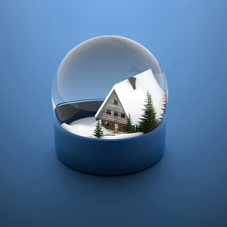 Christmas snow sphere blue with house and trees photo