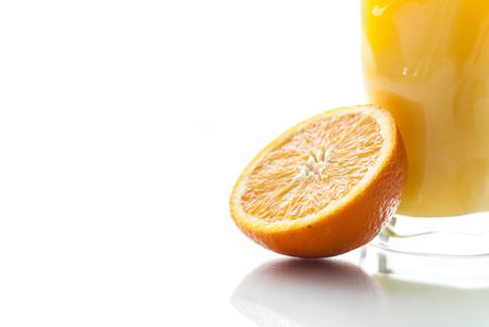 Fresh orange juice on white background with orange.