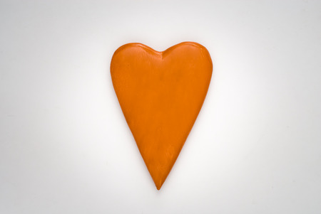 Valentines day celebration concept background. Orange hearth. Reklamní fotografie