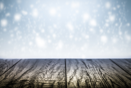 Winter background scene with wooden desk with snowflakes. Reklamní fotografie