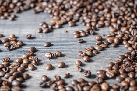 Coffee beans concept on wooden table background.