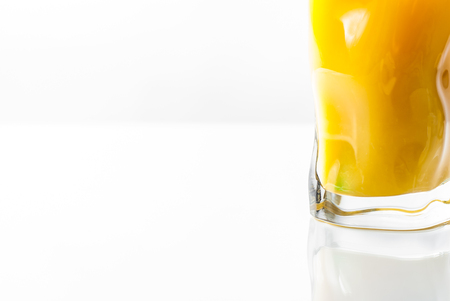 Fresh orange juice on white background.