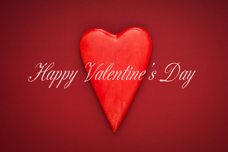 Valentines day celebration concept background. Valentines red hearths on red background. Valentine card.