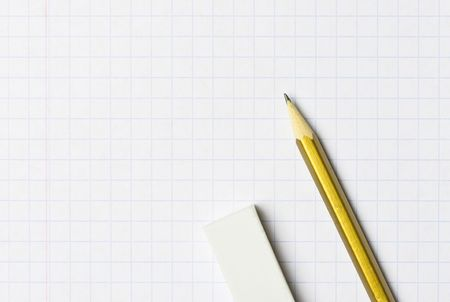 fundamentals: A pencil and an eraser on the exercise book Stock Photo