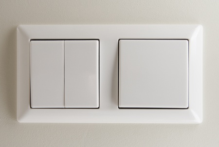 switches: Two light switches on wall Stock Photo
