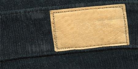 zigzagger: Blank leather label on black jeans