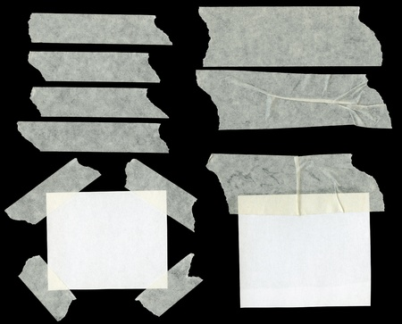 Pieces of sticky paper on black background photo