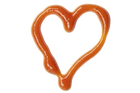 squeeze shape: ketchup heart symbol, isolated on white background Stock Photo