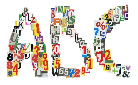 uppercase: ABC letters made of newspaper letters, numbers and punctuation marks, isolated on white Stock Photo