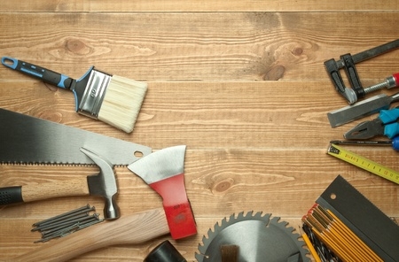 Different tools on a wooden background. photo