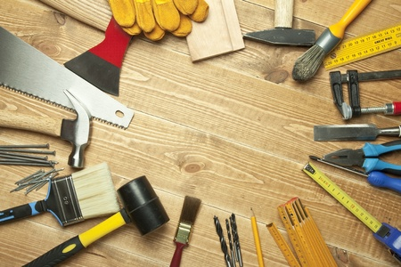 RENOVATE: Different tools on a wooden background.