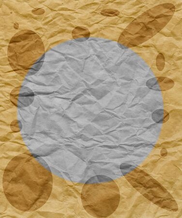 Old crumpled brown paper background with circles photo