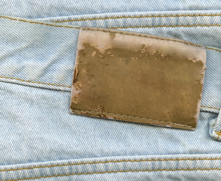 Blank leather label on blue jeans photo