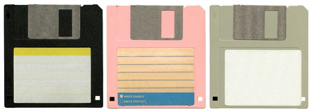 three old worn floppy discs photo