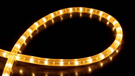 Glowing garland on black background photo