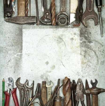 Heap of old tools on a metal background Stock Photo
