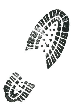 footprint: Huella de zapato negro sobre fondo blanco Foto de archivo