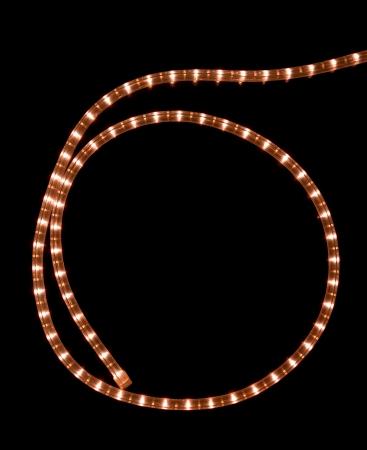 Glowing garland on black background photo