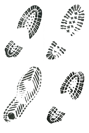 tred: Black shoe prints on white background Stock Photo