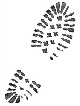 huellas de pies: Huella de zapato negro sobre fondo blanco Foto de archivo