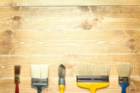 Different paintbrushes on a wooden background Reklamní fotografie