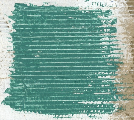Textured green painted cardboard  photo
