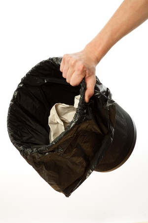 wastepaper basket: Hand holding trash bin with paper in it