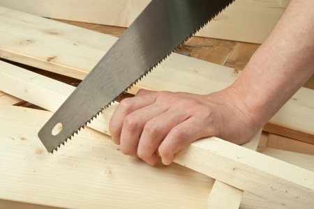 carpenter tools: Sawing plank on a wooden background Stock Photo