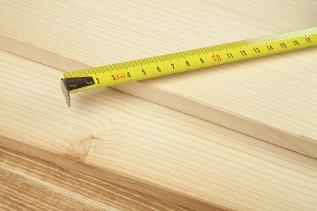 yelloow: Yelow ruler over wooden background. Stock Photo