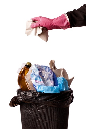 black plastic garbage bag: hand throwing rubbish in a trash bin