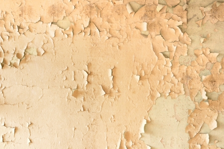 Old yellow cracked paint wall photo