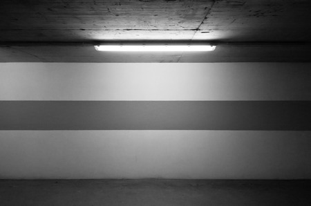 car park interior: Underground parking wall and a lamp Stock Photo