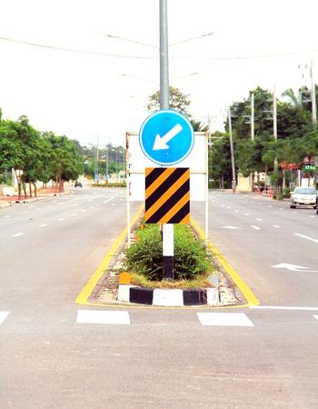 asphalt road with traffic sign photo