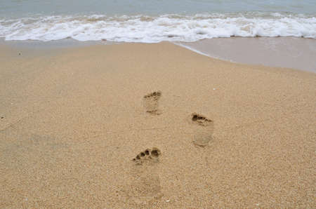 Footmark on the beach,It Stock Photo - 13549359