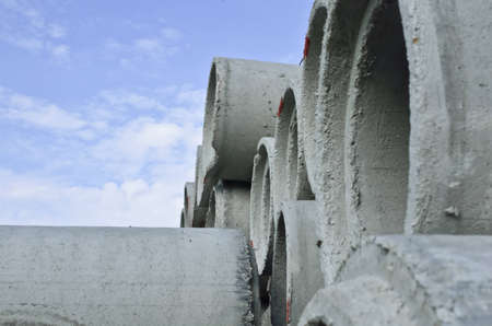 close up of concrete pipe and blue sky