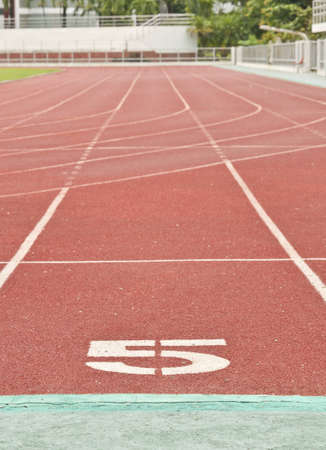 number five on the start of a running track photo