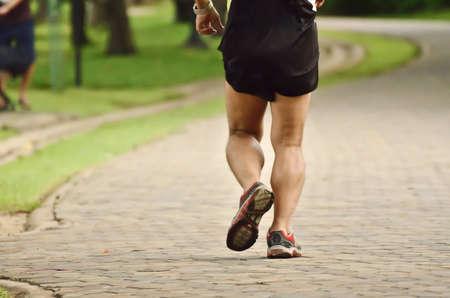 man jogging in public park