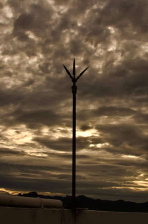 lightning rod and cloudy sky at sunset Stock Photo - 14895201